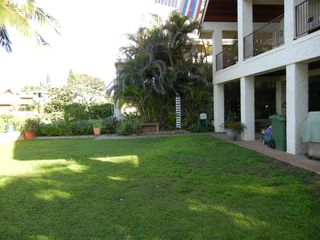 Makaha studio photo - Lawn view with barbecue, tables, chairs, outdoor shower. Everything you need