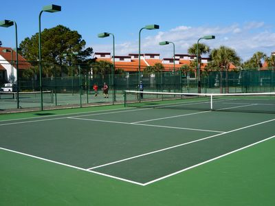 Tennis courts on property.