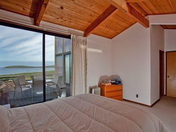 Upstairs bedroom with deck and view of Pacific Ocean