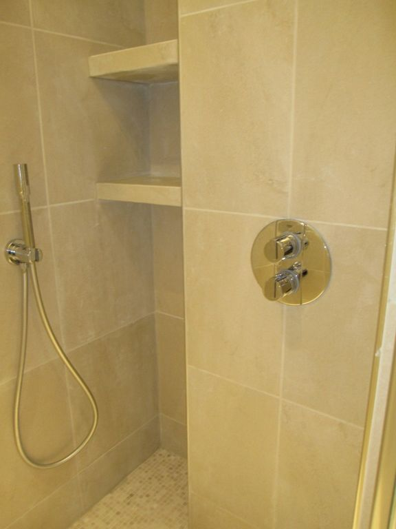 Modern shower unit. Tank less water heater for your enjoyment without concerning