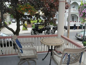 View from the Puffin Front Porch. Gaslight Lamps and Horse and Buggy carriages