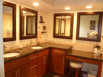 Master bathroom counters with granite tops and dressing table