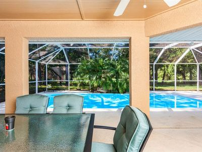 Gather the family in the lanai for lunch - At Wood Haven, you can enjoy the outside as much as the inside. Spend time by the pool, out on the deck, or enjoy have a yard to play in!