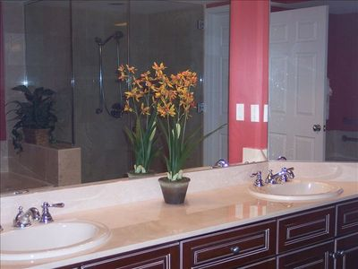 Master bath has large jetted tub and walk-in shower