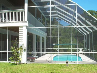 Large screened private pool and shaded gathering area