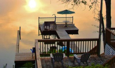 Enjoy the sunsets from this multi-level deck and boat dock with plenty of places to spread out, stretch out and chill out, all with panoramic views of the peaceful waters of central Georgia's Lake Sinclair.