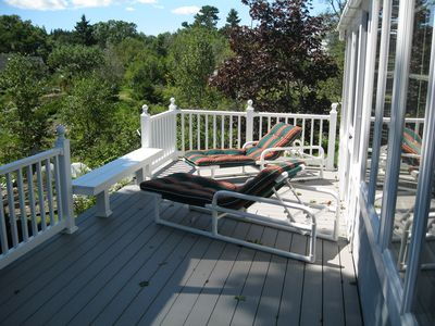 Front deck with comfortable chaise lounges