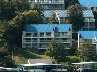 waterfront building watch boats as ya sip on a cold drink/middle level/far left - Osage Beach villa vacation rental photo