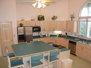 Corolla house photo - Airy, open kitchen with premium appliances and center island for chef's friends