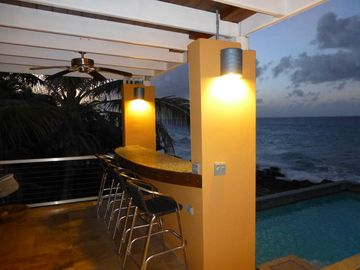 Start the night with drinks on our new Bar overlooking the Pool, and Caribbean