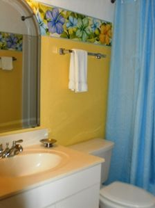 Perky yellow 2nd bath. Dont Forget your linens are included when you book here!