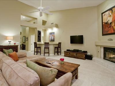 "Family room features gas fireplace, 47"" flat panel TV and wet bar"