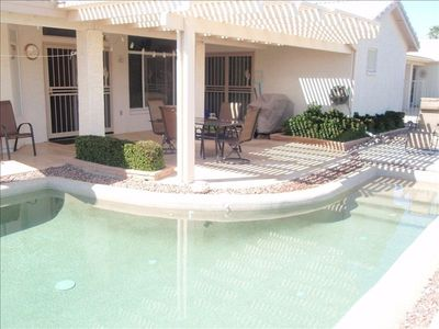 Pool with patio furniture, BBQ on the 11th Fairway of Eagles Nest Golf Course.
