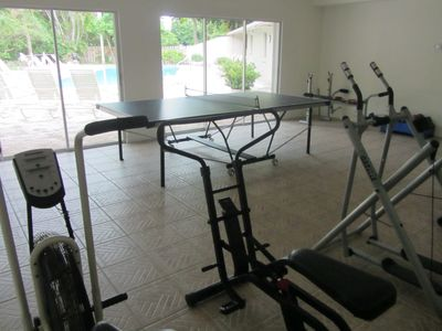 "Exercise equipment and ping-pong in club house, including a 60"" flat screen TV"