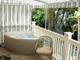 Hot tub on balcony overlooking tropical gardens
