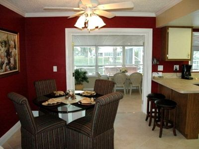 Extra dining in Florida Room (for 10) with water view