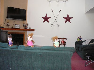 North Conway condo rental - Living room couches, fireplace and flat screen t.v, for the Discovery Channel.