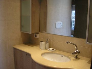 Master bathroom,with bath and toilet.