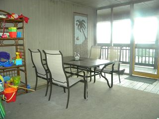 North Topsail Beach condo photo - Front Porch w/ Seating Area - Beach Toys, Chairs, Umbrellas