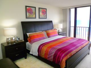 Hutchinson Island condo photo - Master bedroom with king size bed, alarm clock, wireless phone