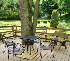 Roan Mountain house photo - Outside deck overlooking the pond; a great place for doing anytime of day !