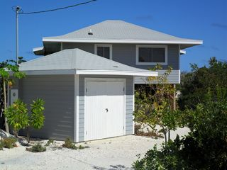 Staniel Cay cottage photo - Sand and rock driveway from road and owners garage.