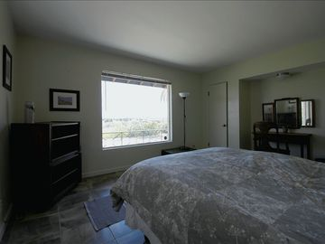 Watch the sunrise from this east facing bedroom with queen bed