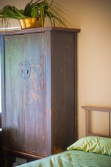 Austin condo photo - bedroom with antique armoire