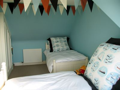Kids room 4 single beds 2 underneath