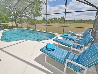Pool with sun loungers and conservation view. (disabled pool hoist shown)