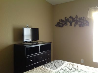Queen bedroom flat screen tv