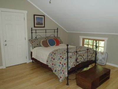 Comfy queen bed, beautiful antique iron bedframe, and brand new bamboo floors