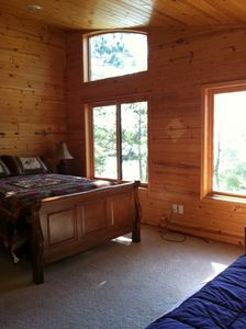 Guest room has a beautiful view of the lake, queen bed & twin w/trundle.