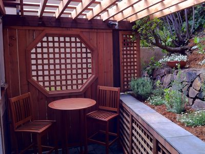 Private backyard opens from kitchen for al fresco dining.