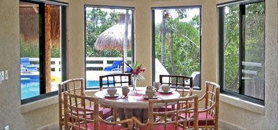 Cozy breakfast nook overlooks the pool and jungle