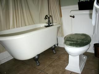 Redondo Beach cottage rental - Clawfoot tub with hand shower and over-head shower