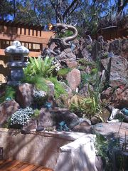 Carmel house photo - Dragon sculpture over waterfall and koi pond