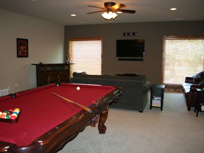 Recreation room with pool table and 53 inch tv.