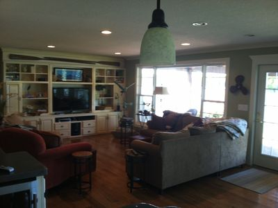 From kitchen looking into living room with large picture window&flat screen TV