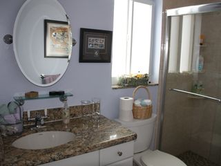 Hollywood condo photo - Bathroom has marble counter, new shower with double shower heads.