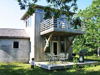 Chilmark house photo - the covered porch, decks, now charcoal grill, taken from the south side yard