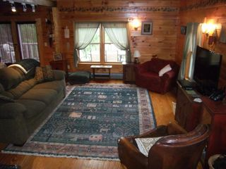 Trenton cabin photo - Great room with cathedral ceilings and wood stove.