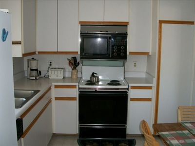 Cozy kitchen fully equipped with all required cooking and serving utensils.