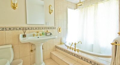 Garden bathroom with soaking tub for two and rain shower faucet.
