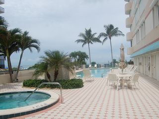Les Falls condo photo - Heated pool and spa overlooks beach!