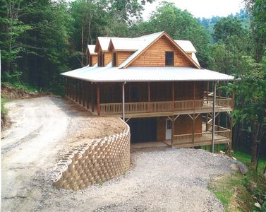 New log cabin, front view, with long mountain views, and a view of the Ski Slope