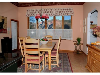 Dining room with extra tables, chairs, linens & dinnerware for groups up to 22.