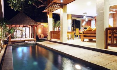 Night view of pool and family room