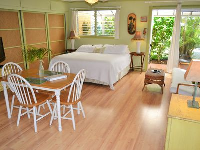 Large open suite surrounded by beautiful tropical plants.