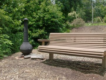 Park Bench with chimnea outside home